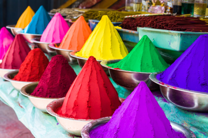 Rows of Colored dye in bowls for festivals.